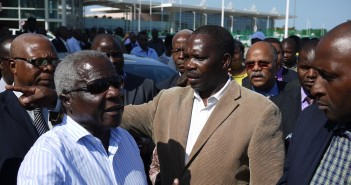 Renamo leader Afonso Dhlakama with party spokesman Antonio Muchanga at Maputo airport in December 2014. Photo © Tom Bowker