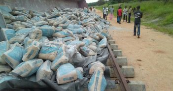 Sacks of cement litter the Sena rail line following the derailment. Photo: Anonymous