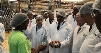 Minister of Trade and Industry, Max Tonela, inspects Sumol-Compal products at the Boane factory.