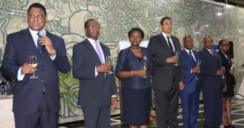 Governor Ernesto Gove addresses the Bank of Mozambique end of year review. De Sousa is pictured in the middle of the row. Photo courtesy Bank of Mozambique