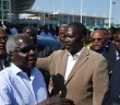 Renamo leader Afonso Dhlakama with party spokesman Antonio Muchanga (centre) and Gilberto Chirindza (right) at Maputo airport in December 2014. Photo © Tom Bowker