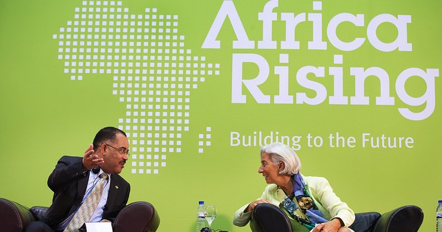 IMF head Christine Lagarde talks with then-finance minister Manuel Chang in Maputo in 2014