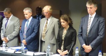 Mediators including former Tanzanian president Jakaya Kikwete (left), Mario Raffaelli (second from left), and Jonathan Powell (right) observe a minute's silence for Jeremias Pondeca at the Mozambique peace talks, 18 October 2016