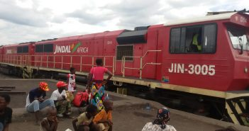 Passengers wait next to a Jindal train at Moatize station. Photo © Fungai Caetano / Zitamar News
