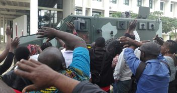 Strikers at Universidade Eduardo Mondlane and riot police in an armoured car.