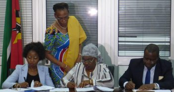 Ivone Soares of Renamo, Margarida Talapa of Frelimo, and Lutero Simango of the MDM (seated, L-R) sign an MoU on 27 March 2018. Photo © Alexandre Nhampossa / Zitamar News
