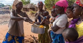Women feed their children enriched porridge in Cabo Delgado province thanks to the Aga Khan Foundation's Enhancing Food Security and Incomes (FSI) initiative