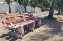 """Prove your love, take an HIV test with me""; a bench in Maputo"