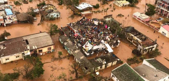 An aerial photo of Cyclone Idai survivors awaiting rescue on top of a building amid flood waters.