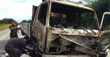 The truck that was burned out following the 10 May attack, along with the passenger minibus. Photo from Facebook page of Angela Maria Serras Pires